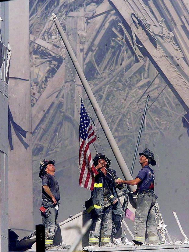 Northwich Guardian: First responder raise the American flag on what would become know as Ground Zero. (Gannett)