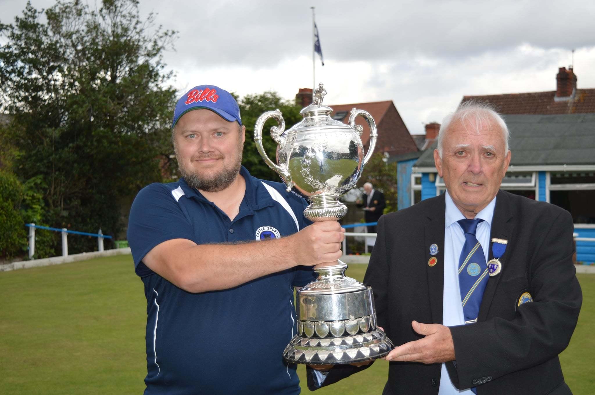 Castle Sports captain Adi Faulkner, left, receives the trophy