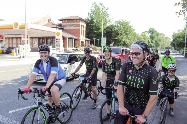 Northwich Guardian: Stuart, second from left, was joined by wife Sarah and other members of Tatton Velo during his leg through Knutsford