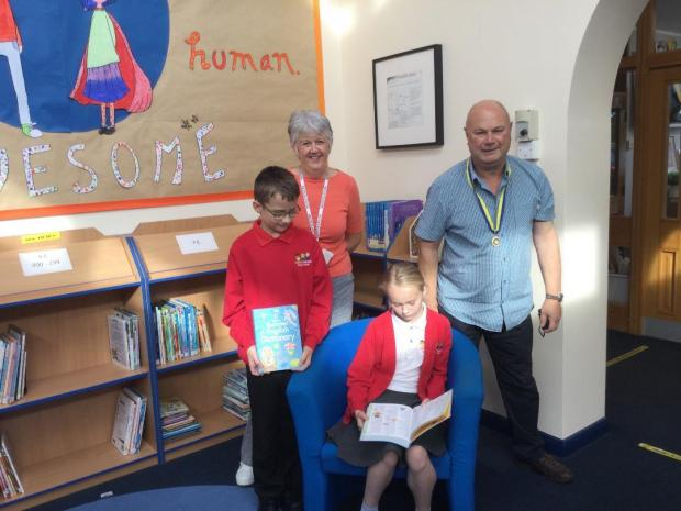 Northwich Guardian: Rupert Adams delivering dictionaries to Leftwich Community Primary School where students Bethany and Matthew, along with their librarian teacher Mrs Akers